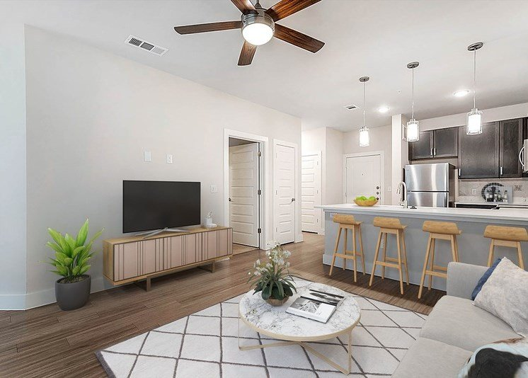 Decorated living room with white and gray rug, ceiling fan, and, television