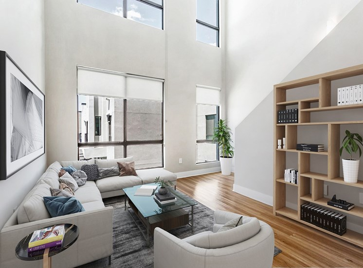 Bright Townhome Style Floor Plan with Contemporary Shelf, Sectional Couch, Armchair and Coffee Table on Area Rug