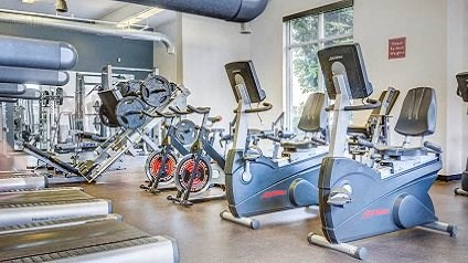 Fitness center with spinning machines and window views