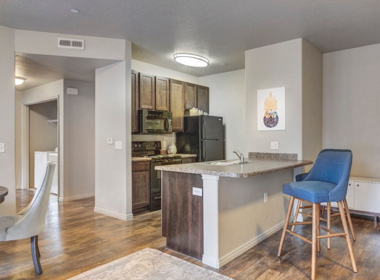 Model Apartment with Open Layout Floor PLan Kitchen with Breakfast Bar
