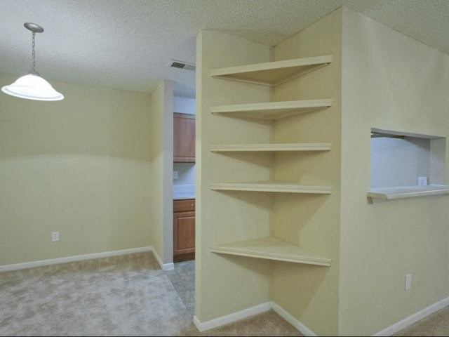 Living Room with Carpet Flooring and Built-in Shelving
