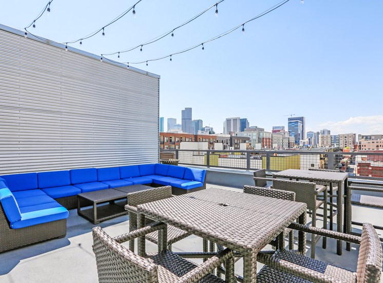 Rooftop Picnic Area with Tables, Chairs, and Patio Sectional with Bright Blue Cushions