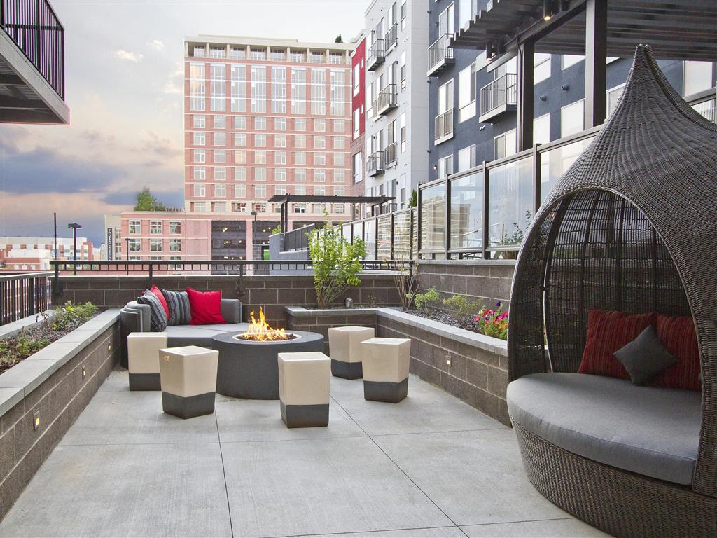 Via Apartments | Poolside Fire Pit