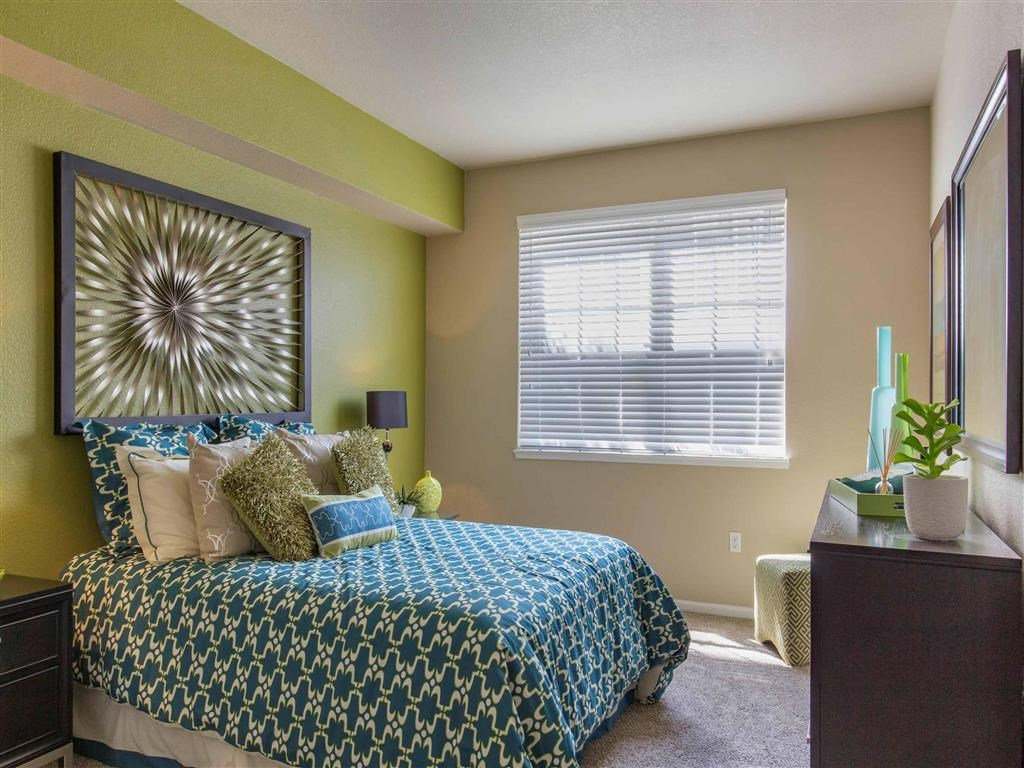 The Village at Legacy Ridge Apartments   Bedroom with Accent Wall