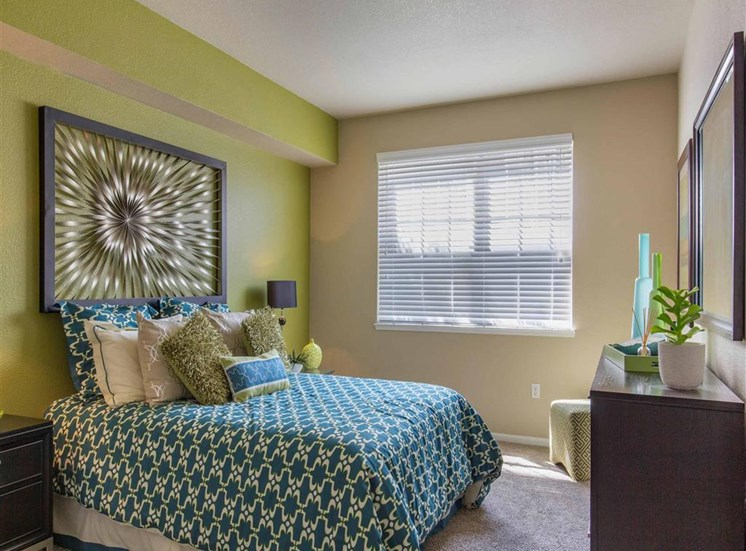 The Village at Legacy Ridge Apartments | Bedroom with Accent Wall