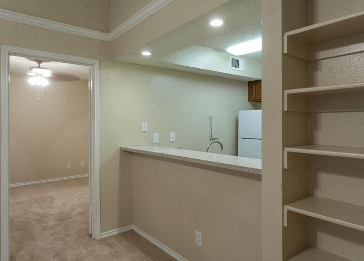 Custom Built-in Shelving, view of kitchen, white trim along the top of the walls