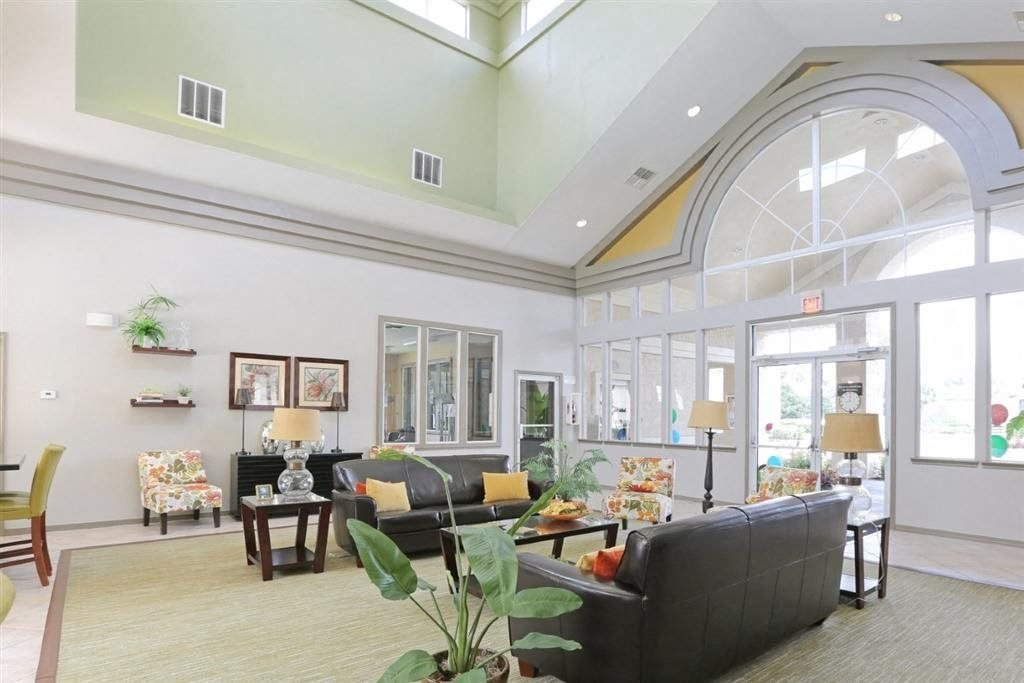 Bright Clubhouse Interior with Large Windows  Couches and Tables