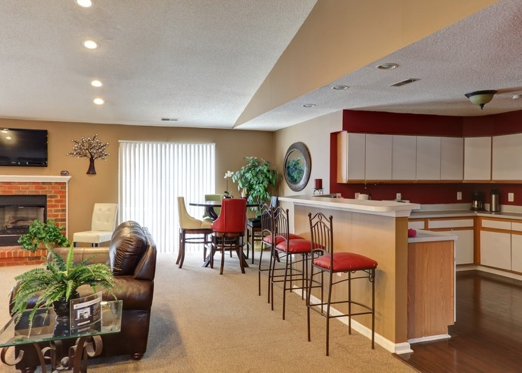 Clubhouse interior with breakfast bar area and bar stools
