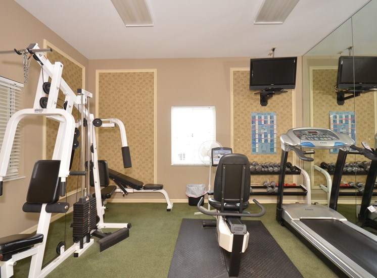Fitness Center with Exercise Equipment at River Park Place Apartments, Vero Beach, FL
