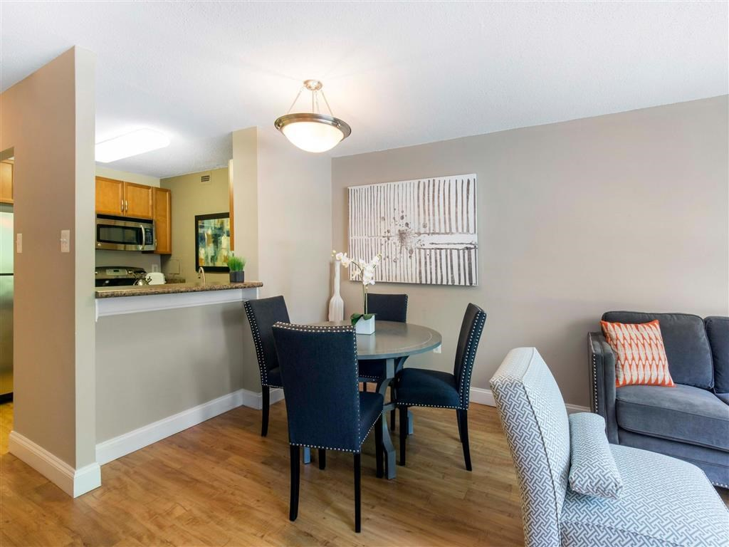 Model Apartment with Breakfast Bar Dining Table and Chairs