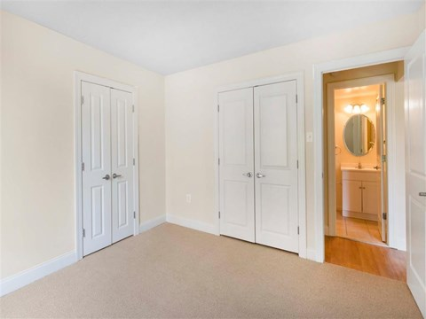 Carpeted Bedroom with Closets