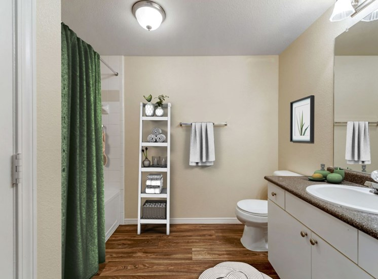 Virtually staged bathroom with towel wrack, large mirror and vanity lighting