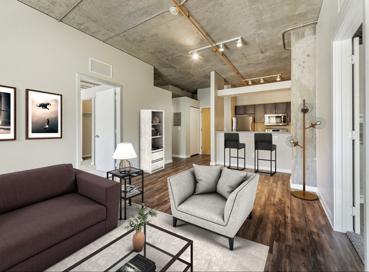 Open Floor Plan Layout with Industrial Finishes, Hardwood Style Flooring and Breakfast Bar off of Kitchen with Virtually Placed Furniture and Decorations