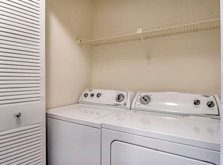 Laundry Closet with White Full Sized Washer and Dryer
