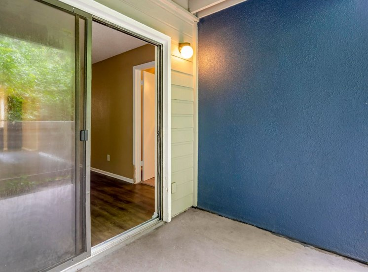 Patio with Sliding Glass Door and Blue Accent Wall