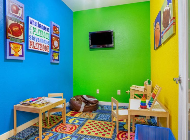 Bright Colorful Activity Room with Mounted TV and Miniature Tables