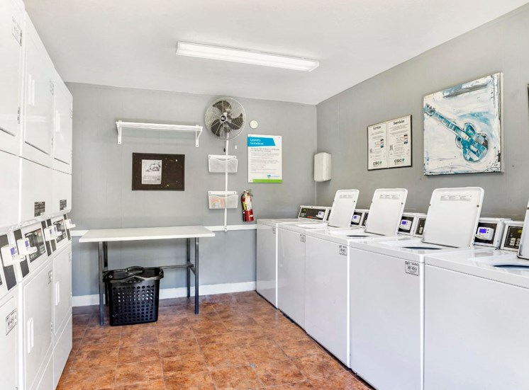 Laundry Center with Machines Next to Folding Counter