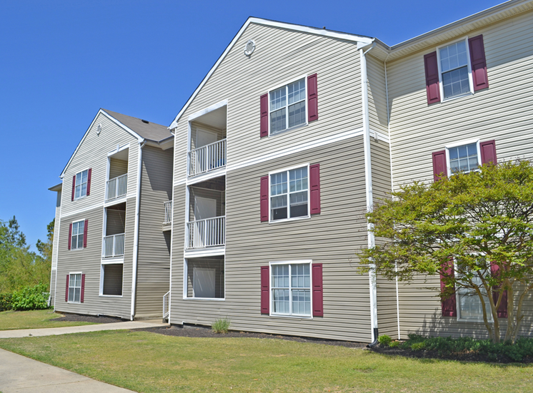 Building Exterior Surrounded By Trees at Autumn Ridge Apartments, Tennessee, 38115