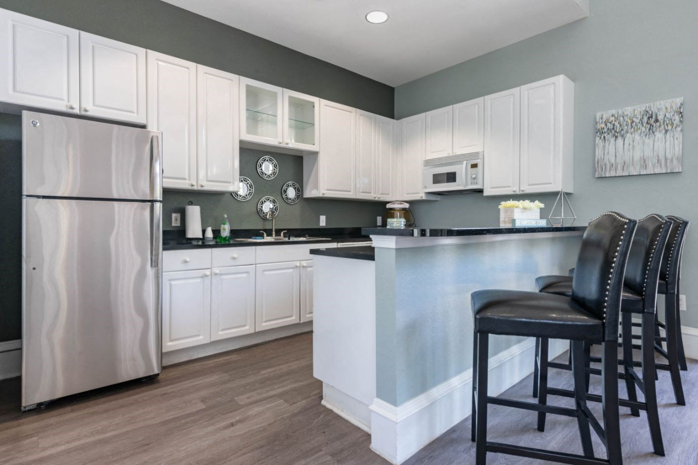 With White Cabinets Black Counters Stainless Steel Appliances