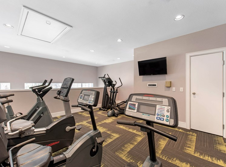 Fitness Center Cardio Equipment with Wall Mounted Television