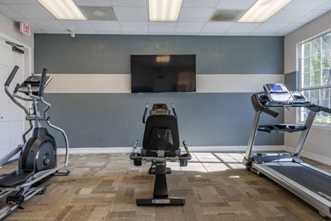 Fitness Center with Exercise Equipment  and TV