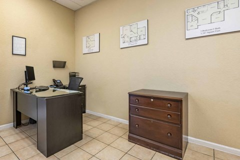 Employee Desk in Leasing Office with Wood File Cabinet