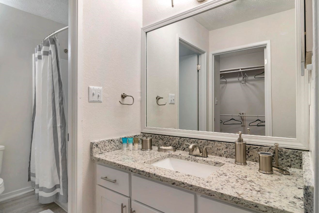 Bathroom with White Counters and Granite Counters with Decoration