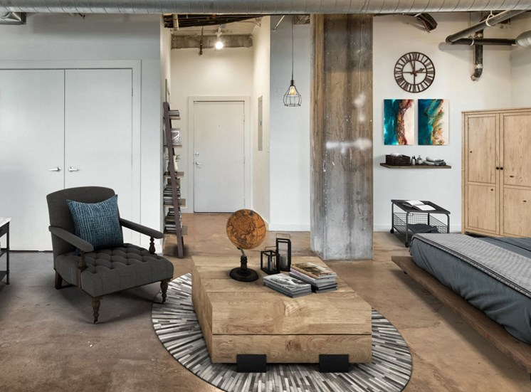 Industrial Style Open Bedroom with Polished Concrete Flooring
