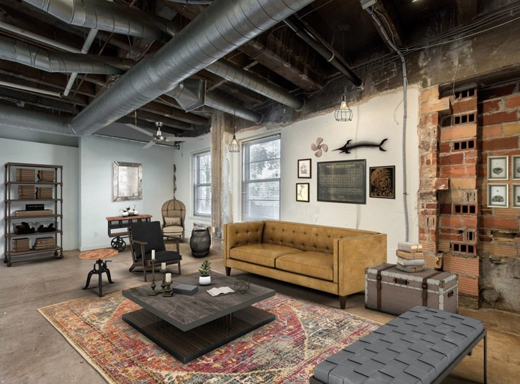 Large Living Room with Exposed Brick and Ductwork with Virtually Placed Couch, Coffee Table, Armchair and Decorations
