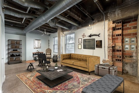 Large Living Room with Exposed Brick and Ductwork
