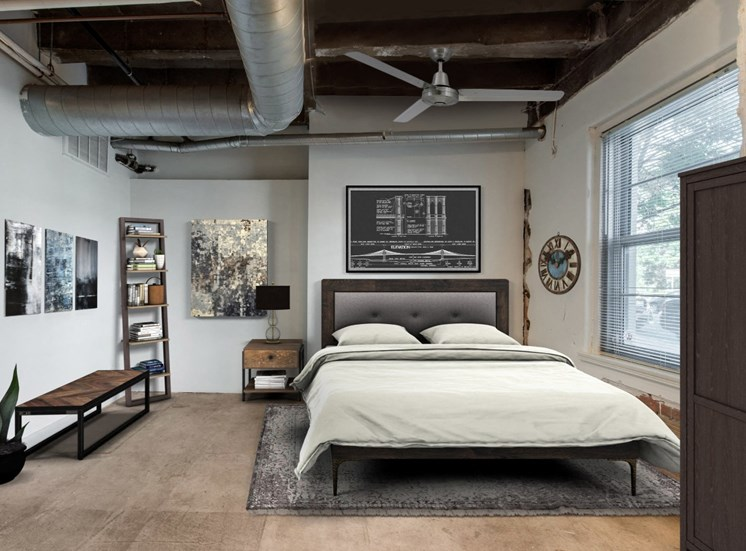 Industrial Style Bedroom with Exposed Brick and Ductwork with Virtually Placed Bed and Decorations