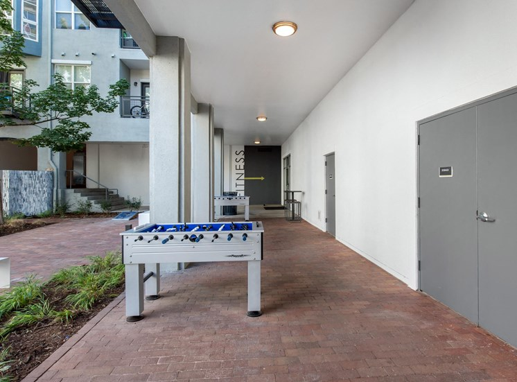 Courtyard and Foosball Table Next to Building Under Cover