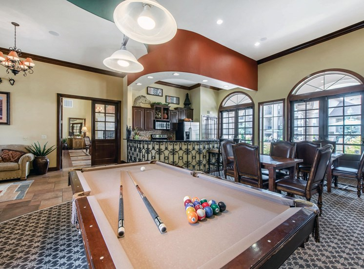 Clubhouse game room with billiard table, and kitchen with breakfast bar