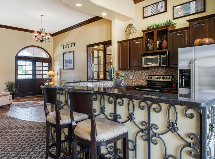 Clubhouse kitchen with stainless steel appliances, and breakfast bar