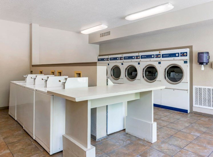 Laundry Facility with Washers Dryers and Laundry Folding Table