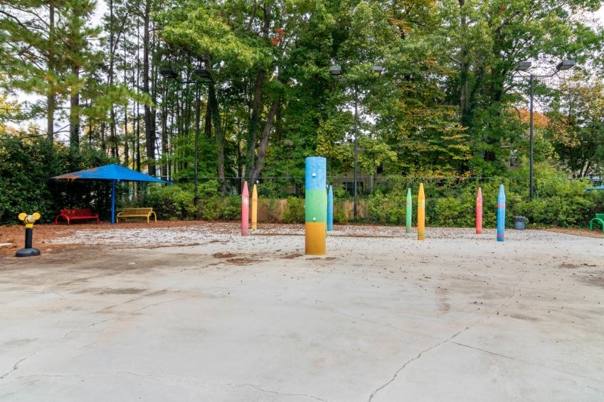 Fenced in Splash Pad with Trees in the Background