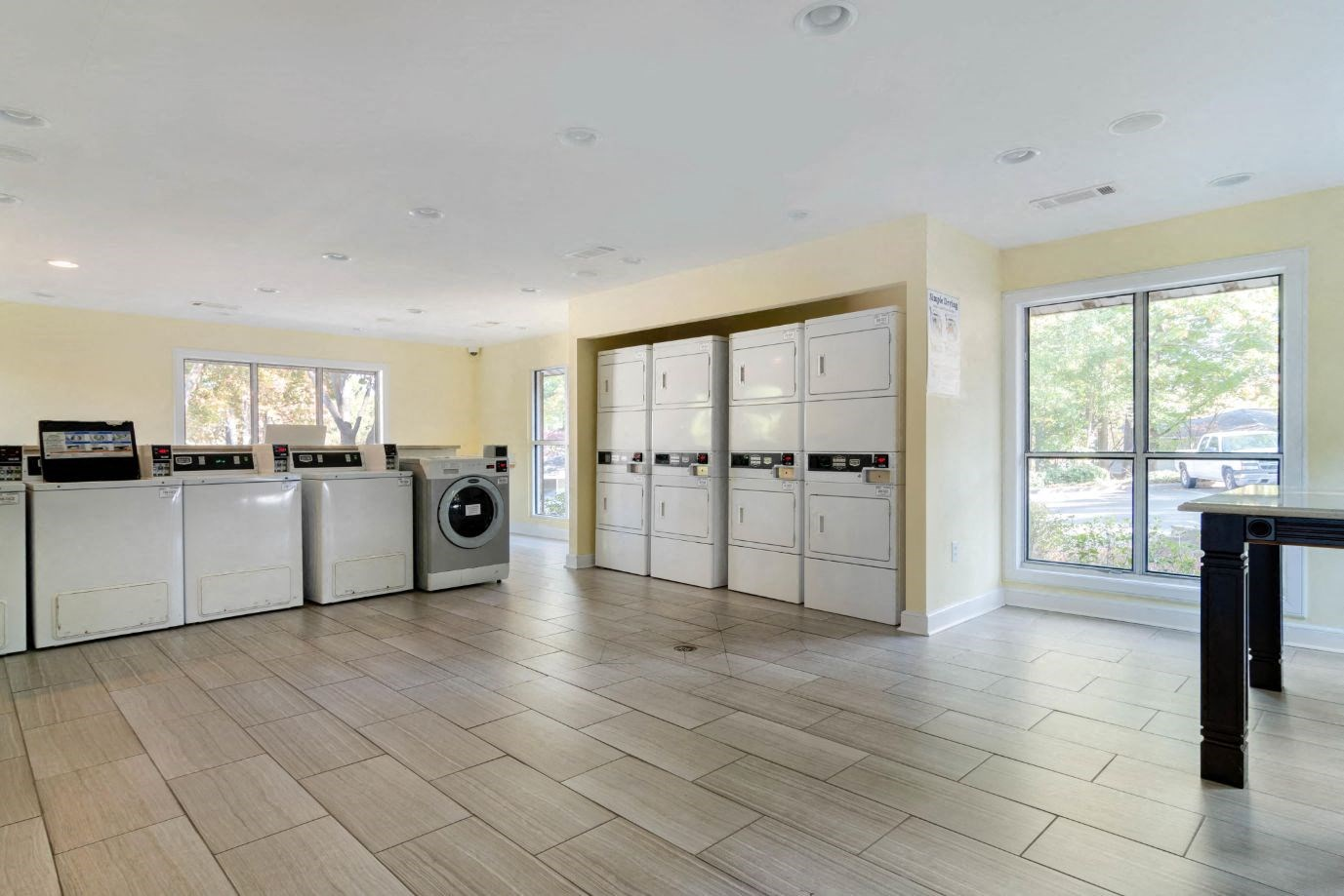 Laundry Service Center with Hardwood Style Flooring  and Machines