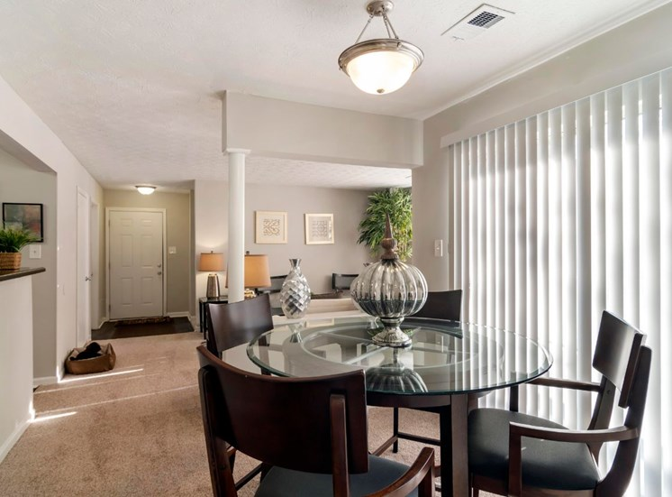 Furnished Model Dining Room with Patio Entrance