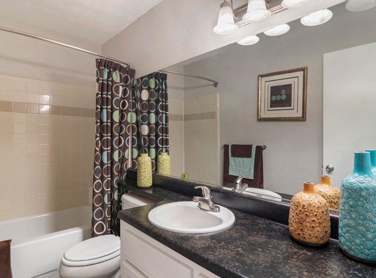 Decorated Model Bathroom with Vanity Lights and Garden Style Tub