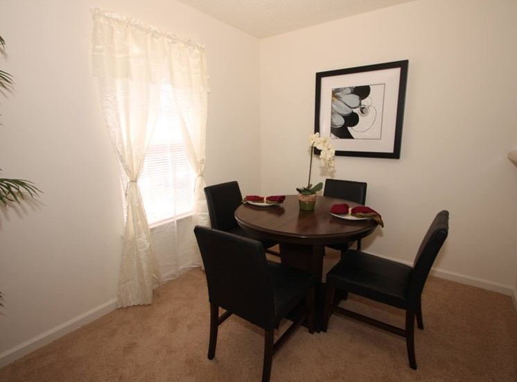 Dining room with a 4 person table by window