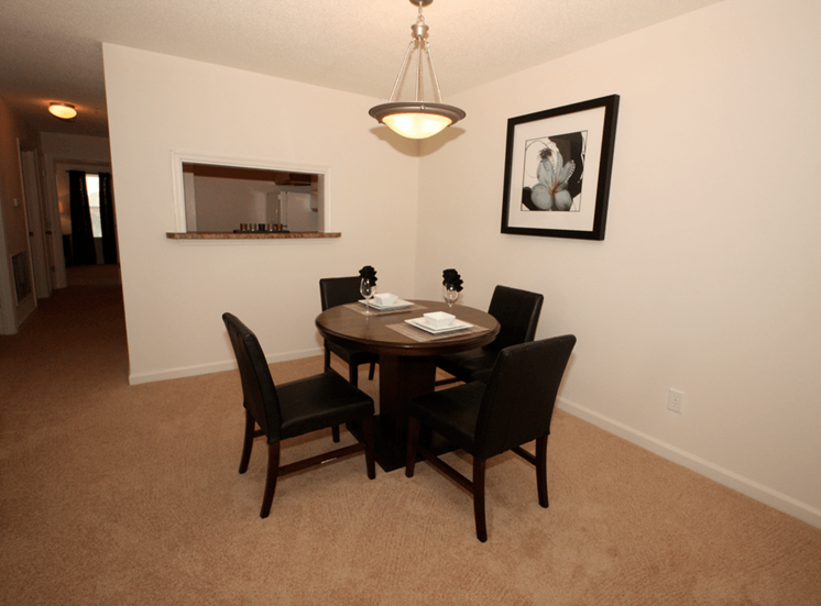 Dining room with carpet flooring and pendant lighting