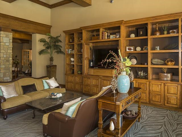 Clubhouse Lounge with Couches and Large Wood Entertainment Center