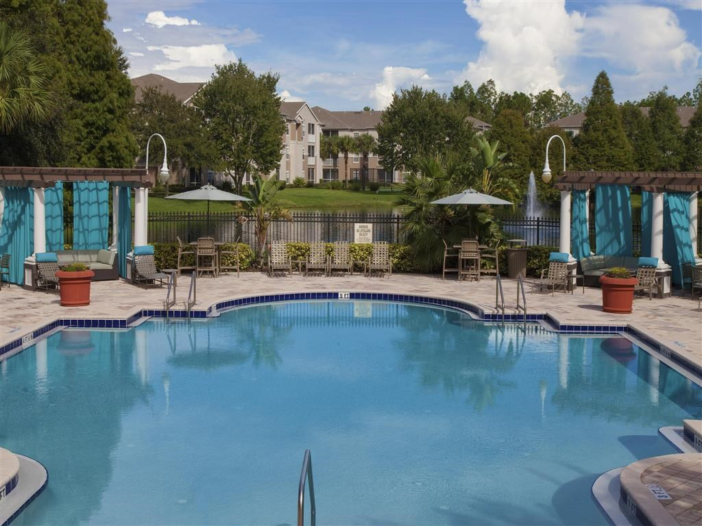 The Legends at Champions Gate | Apartments for Rent in Champions Gate, FL | Swimming Pool with Sundeck Seating