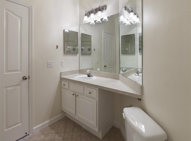 Bathroom with White Cabinets Grey Counters and Double Mirror Next to Mirrored Medicine  Cabinets
