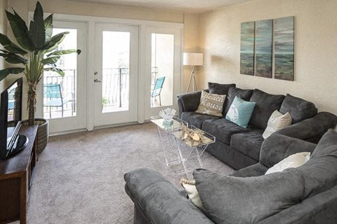 Living Room with Carpeted Flooring and Private Patio Access