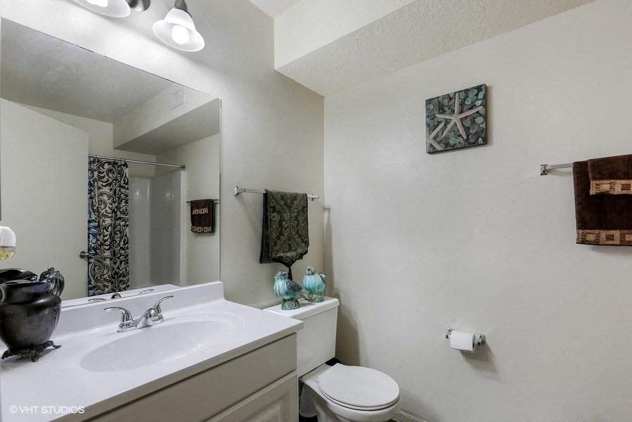 Model bathroom with white countertop and cabinets