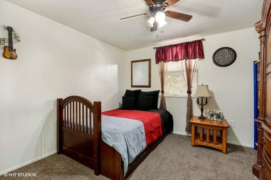 Model bedroom with bed and nightstand