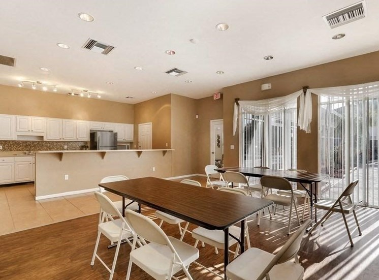 Clubhouse kitchen with tables and chairs