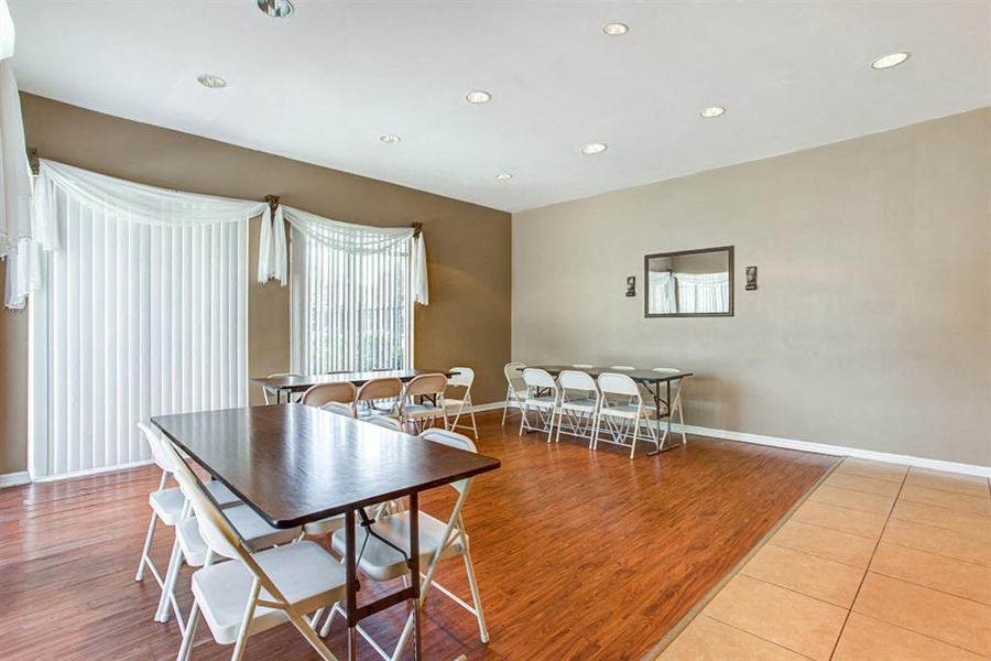 Clubhouse with table and chairs on hardwood style flooring