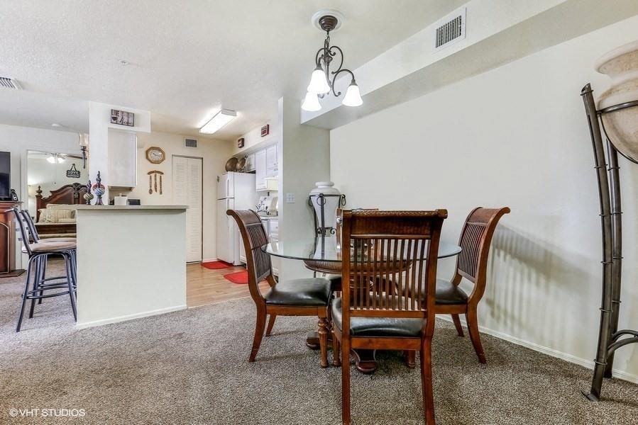 Model dining room with table and chairs